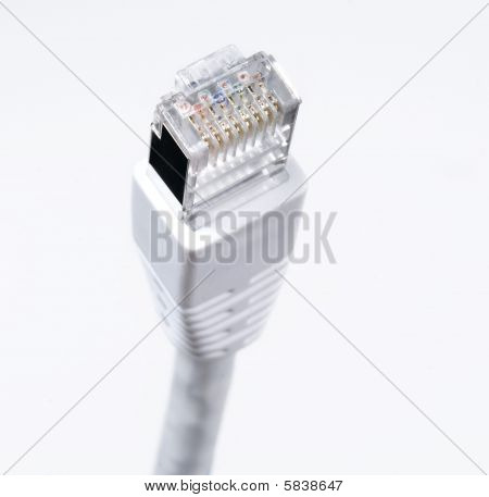LAN cable lightly coiled isolated on white