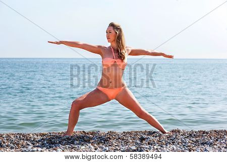 Beautiful Tanned Woman Working Out At The Beach