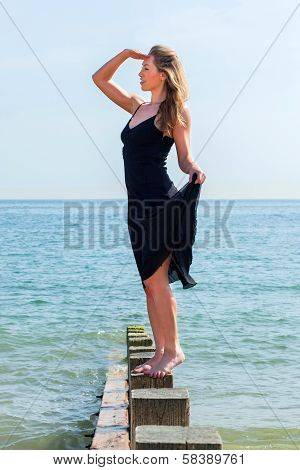 Beautiful Woman Playing Lookout At The Seaside