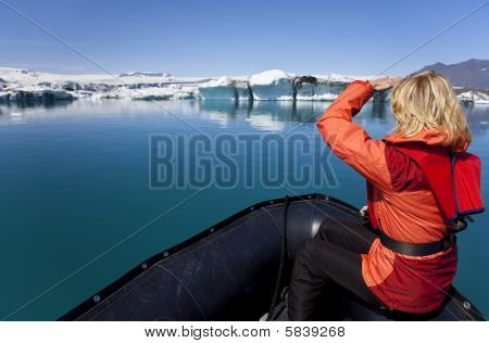 Woman Explorer Using Boat In Iceberg Field, Jokulsarlon Lagoon, Iceland