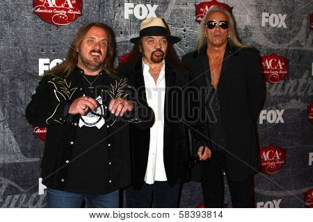 Johnny Van Zant, Gary Rossington and Rickey Medlocke of Lynyrd Skynyrd at the 2012 American Country Awards, Mandalay Bay, Las Vegas, NV 12-10-12