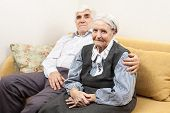 foto of mother law  - Mature man and senior woman while sitting on sofa
