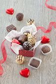 pic of truffle  - A variety chocolates and truffles on a grey background - JPG