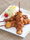 picture of sate  - Delicious Asian Cuisine Chicken Satay  skewered and grilled  - JPG
