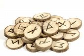 foto of wicca  - studio shot collection of old wooden runes - JPG