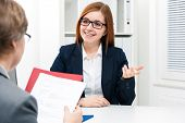 stock photo of interview  - Young woman discussing during a job interview at office - JPG