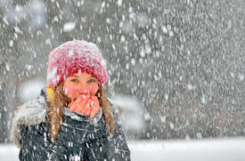 stock photo of freezing  - freezing young woman warming his hands shoot in winter day - JPG