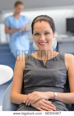 Businesswoman patient sitting chair at dental surgery teeth checkup