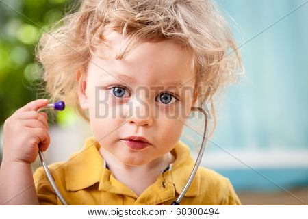 Portrait Of A Cute Little Boy With Stethoscope