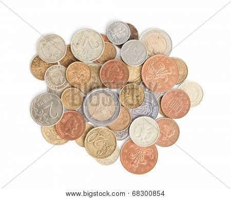 Scattering silver and gold coins, isolated on white background. A great number of coins symbolize wealth, richness, income and profit. Close up shot.
