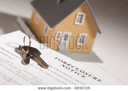 Foreclosure Notice, House Keys And Model Home On Gradated Background