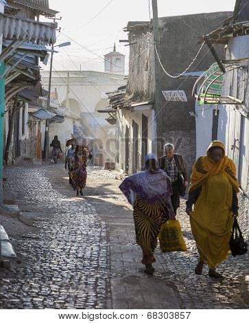 People of ancient walled city of Jugol in their morning routine activities that almost unchanged.