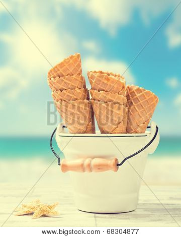 Empty icecream wafer cones with beach blur background - vintage tone added