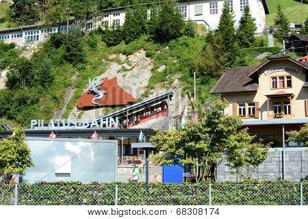 ALPNACHSTAD, SWITZERLAND - July 3, 2014: The Pilatus-Bahn, the world's steepest cogwheel railway takes passengers to the summit of Mt. Pilatus with spectacular views of the Lucern Valley.