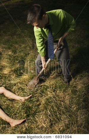 Businessman Burying Dead Body