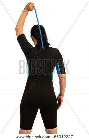 Surfer Closing Zipper To Neoprene Suit