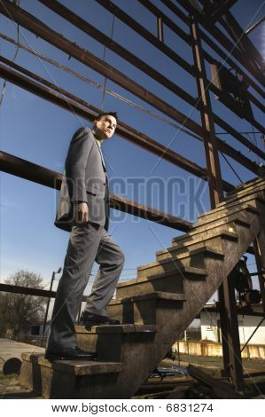 Young Businessman Walking Up Stairs