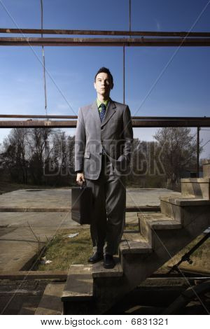 Young Businessman Standing On Stairs