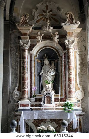 RIOMAGGIORE, ITALY - MAY 02, 2014: Altar of the Virgin Mary with Child in the Saint John the Baptist church in Riomaggiore, Liguria, Italy one of the Cinque Terre villages, UNESCO World Heritage Sites