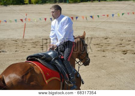 LYTKARINO, MOSCOW REGION, RUSSIA - JULY 12, 2014: Sergey Murugov performs stunts during Russian championship in trick riding. Lytkarino housed the Russian Federation of trick riding
