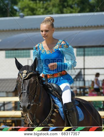 LYTKARINO, MOSCOW REGION, RUSSIA - JULY 12, 2014: Alexandra Kalinina warms up her horse during Russian championship in trick riding. Lytkarino housed the Russian Federation of trick riding