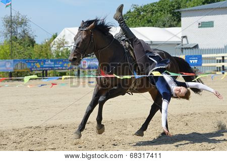 LYTKARINO, MOSCOW REGION, RUSSIA - JULY 12, 2014: Alexandra Lanchina performs stunts during Russian championship in trick riding. Lytkarino housed the Russian Federation of trick riding