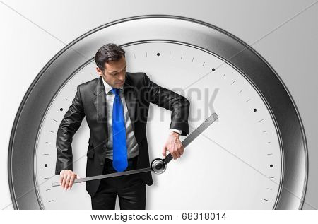 Mature man in a suit with a clock