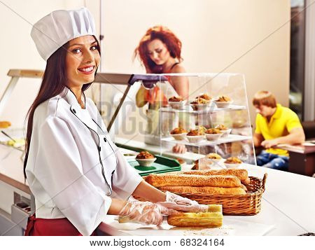Female chef baking baguette bread