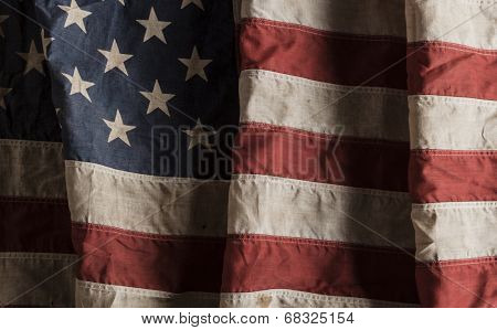Close-up of a weathered american flag
