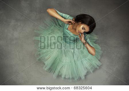 Elegant Brunette In Green Dress Posing In The Studio