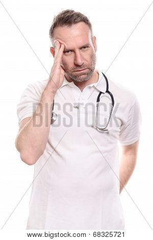 Male Doctor Suffering From A Headache