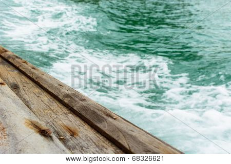 Edge Of Wooden Boat Sailing In The Sea