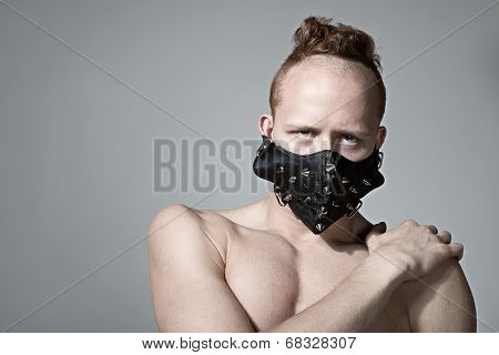 Red head fashion man model in muzzle.
