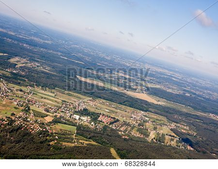Aerial view on field meadows and forest near Warsaw, Poland