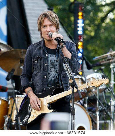 NEW YORK-JUL 11: Country music singer Keith Urban performs on ABC's 'Good Morning America' concert series at Rumsey Playfield, Central Park on July 11, 2014 in New York City.