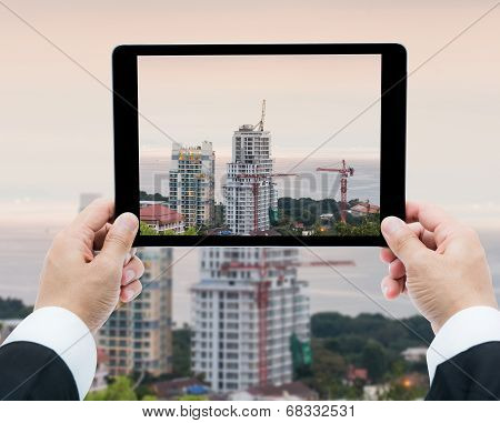 Businessman Hands Tablet Taking Pictures Buildings Under Construction And Cranes