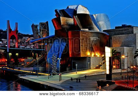 BILBAO, SPAIN - NOVEMBER 14: The Guggenheim Museum and the estuary at evening on November 14, 2012 in Bilbao, Spain. This picturesque and futuristic museum was designed by Frank Ghery