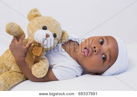 Adorable baby boy with teddy at home in the living room