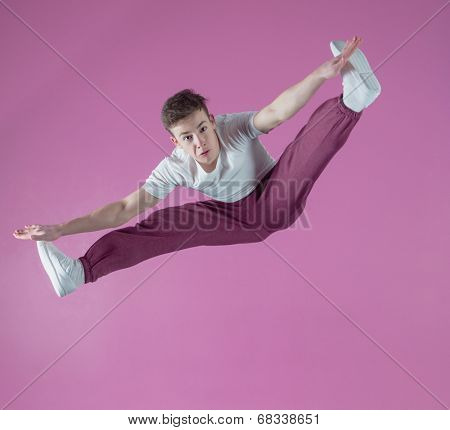 Cool break dancer mid air doing the splits in the dance studio