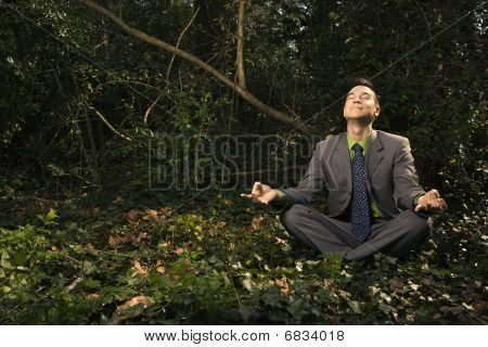 Businessman Sitting In Meditation Outside