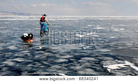 Bicycle Tourist On The Frozen Lake