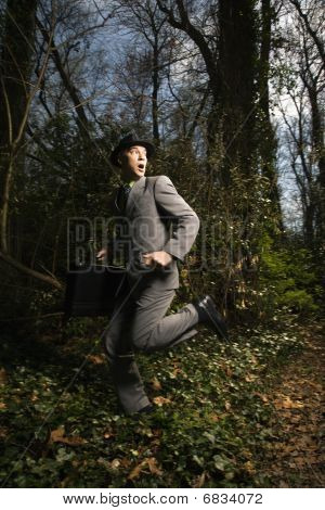 Young Businessman Running In Woods