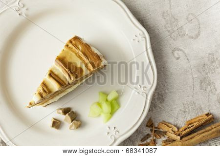 Melon And Caramel Cake Slice On A Plate