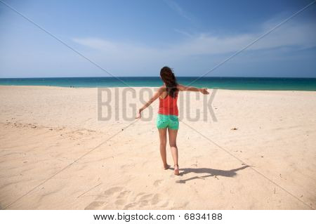 Female Dancing At The Beach