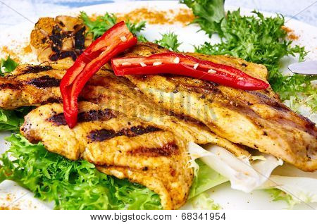 Close up of chiken with peppers and lettuce