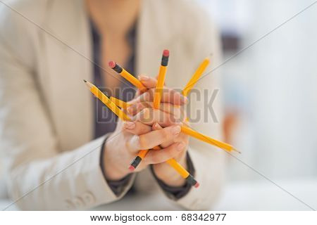 Closeup On Business Woman Playing With Pencils