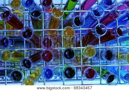 closeup of a pile of test tubes with liquids of different colors