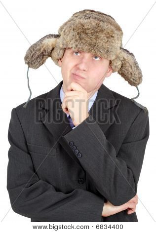 Young Man In A Fur Hat Dreams On White Background
