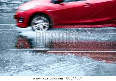 Red Car In A Downpour
