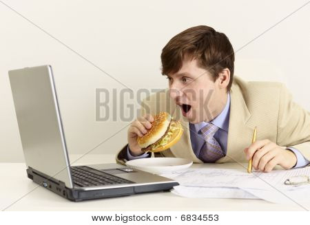 Young Businessman Is Going To Eat Sandwich